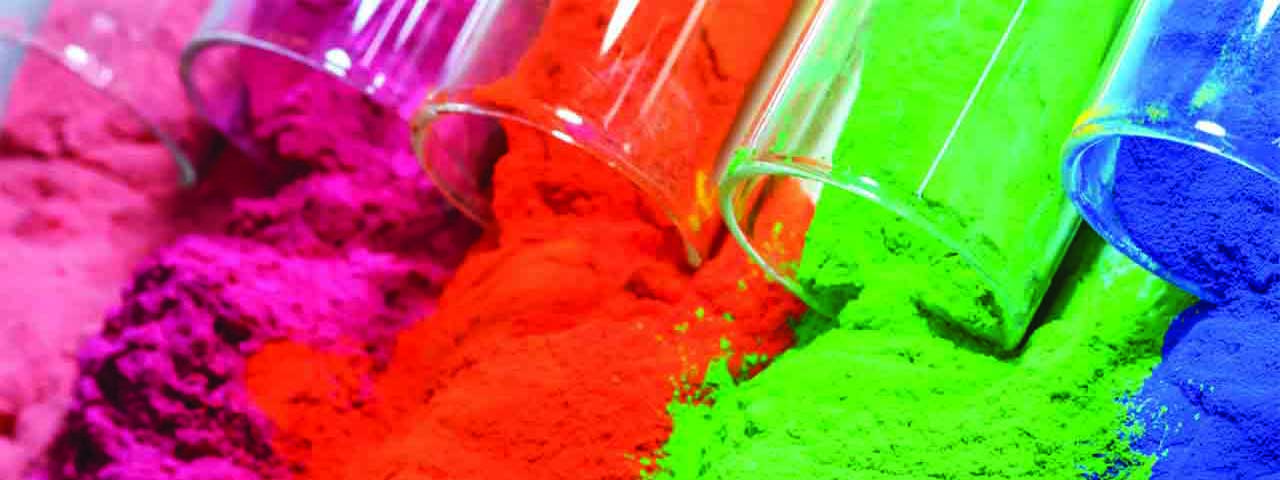 Bright coloured powders poored from tubes, a product we offer in Chemical Solutions