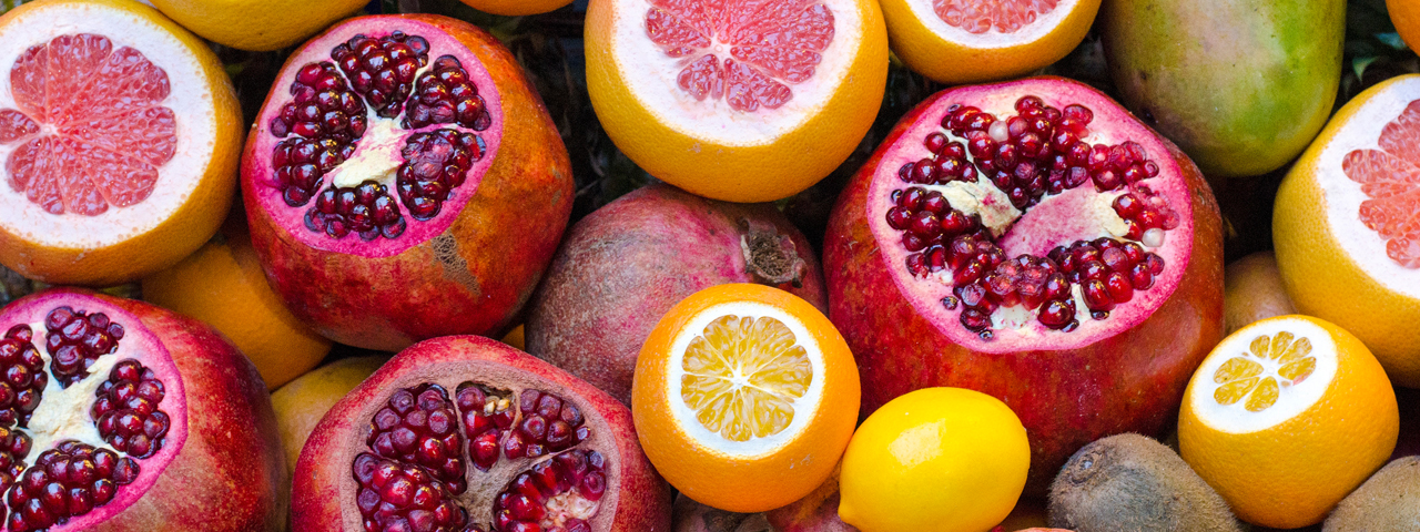 Colorful fruits full of vitaminc C and antioxidants, such as lemons, grapefruit and pomegranate.