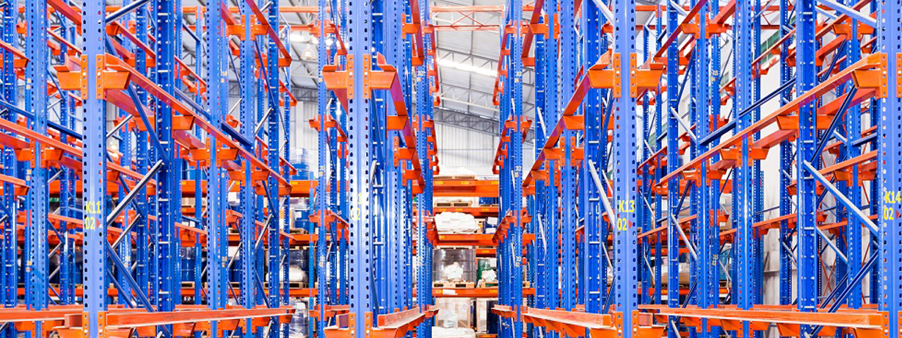 Blue and orange shelves in a warehouse