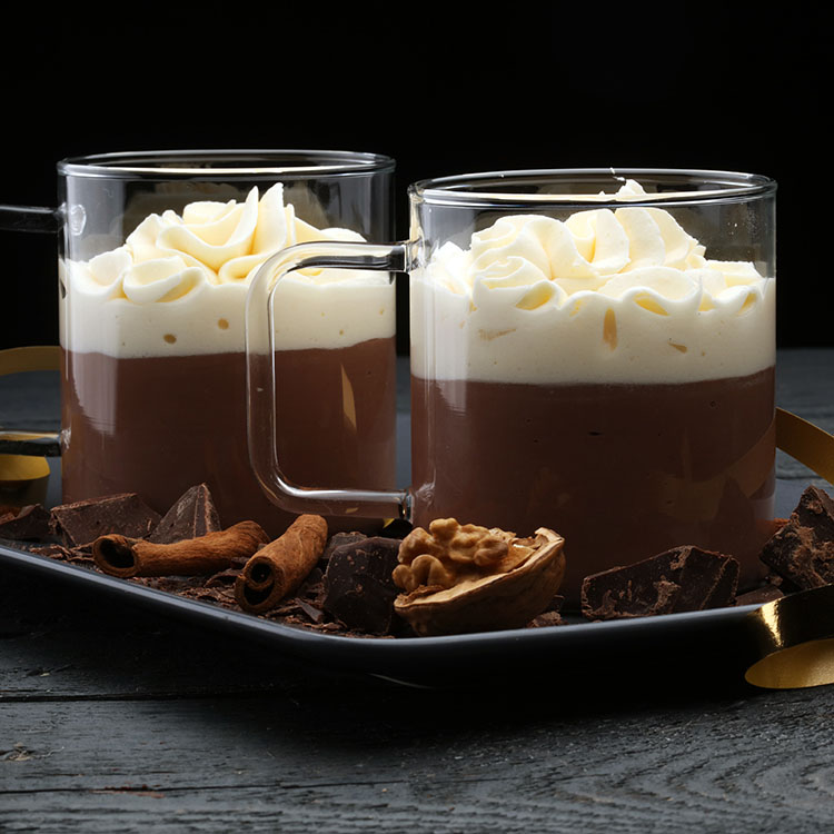 2 glasses filled with chocolate pudding, topped with cream monodiglycerides