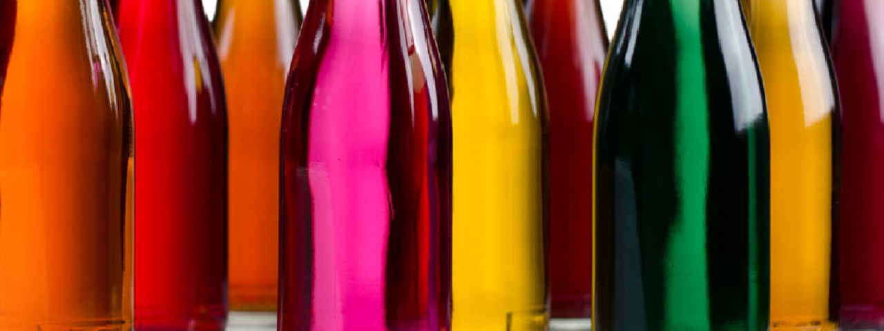 Glass bottles full of colorful liquids - Red, Fuchsia, Yellow, Purple and Green