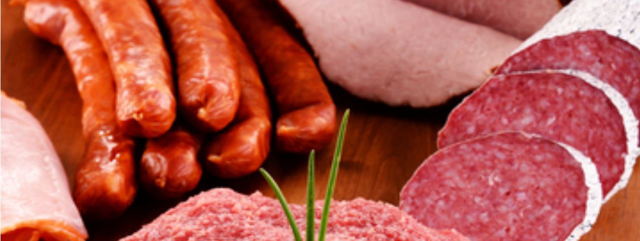 A variety of meat such as smoked sausages, ground beef, salami and ham.