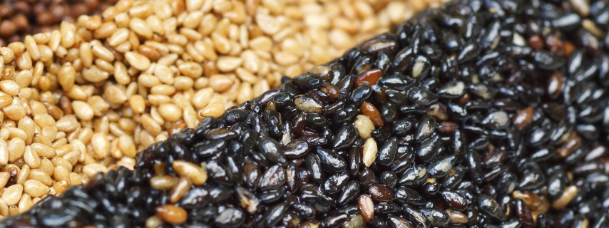 Rows of black, natural and dark brown grains.